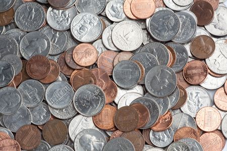 A pile of American money, including quarters, nickles, dimes, and pennies photo