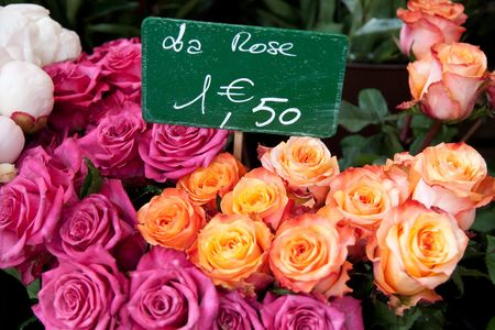 Boques of multi-colored roses with a french price tag
