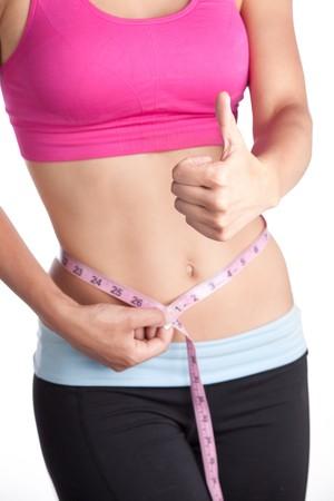 dieting: Dunne vrouw duim schroef opwaarts  Stockfoto