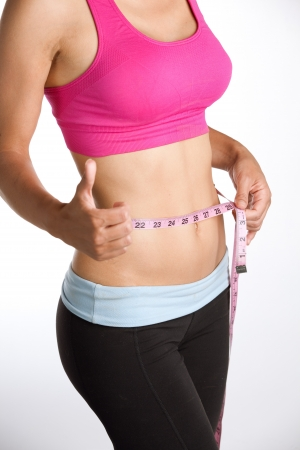 Woman Measuring Waist Thumbs Up Stock Photo