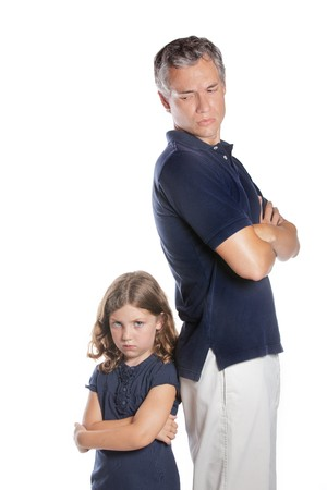 A cute sassy little girl shows she is upset during a conflict with her parent father Stock Photo - 8255594