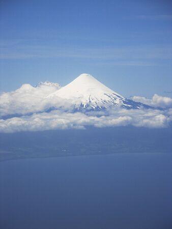 The imposing Osorno Volcano with its white snow peak Banco de Imagens