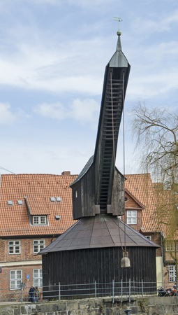 incidental people: The Old Crane in lüneburg,germany Stock Photo