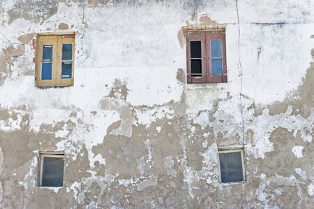 jalousie: Two classic jalousie windows in old house wall. Stock Photo
