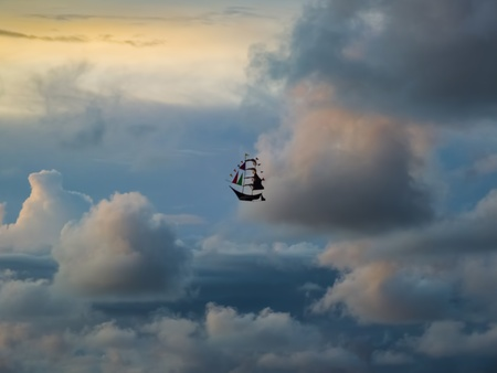 schooner: Boat Kite Sailing in The Stormy and Cloudy Sky To Bright Future