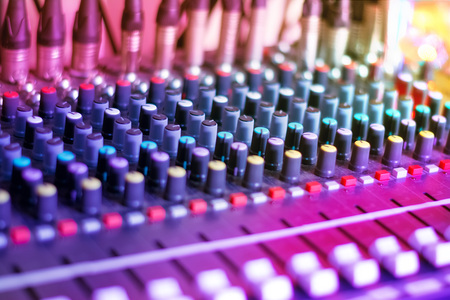 DJ Audio Mixing Console. Sound Music Mixer in Night Club Party. Selective Focus.