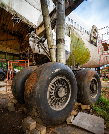 Landing Gear of Aircraft at Airplane Graveyard or Cemetery. Old Plane Being Recycling of Its Part at Storage Facility.