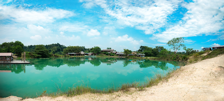 Clean Peaceful Jade Green Blue Lake with Cloud Reflection and Blue Sky. Crystal Clear Blue Pond with White Sand at Cisoka Cigaru Lake. Ecotourism and Environment Awareness Concept
