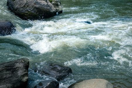 Wild River Water Stream Between Big Granite Rock. Rivulet Water Flowing Rushing By Big Stone Boulder. Standard-Bild - 121410139