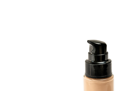 Foundation Bottle with Pump on White Background as Negative Space for Text or Copy Writing. Close Up. Selective Focus. Standard-Bild - 123490443