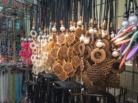Street Seller of Traditional Bead Necklace Made From Brown Coconut Shell