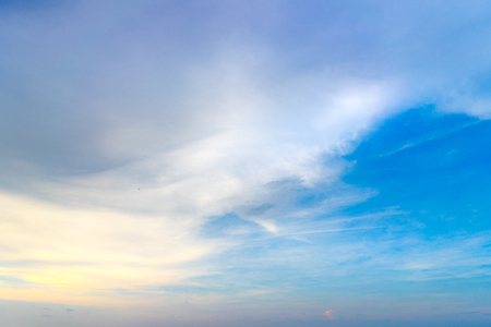 Soft Pastel Color Silky Cloud Mixing with Dark Grey Cloud on Blue Sky During Sunrise Standard-Bild - 123491211