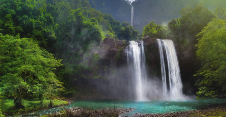 Twin Waterfall Rain Forest In Valley Like A Paradise Garden With Turquoise Green Pond and Blur Waterfall  Mountain Behind. Curug Sodong Amidst Tropical Rain Forest in Global Geopark Ciletuh with Cataractagenitus Cloud From Water Splash