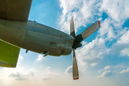 Two Engine Aircraft Propeller of Turboprop Airplane Flying High in Cloudy Sky with Sun Shine Brightly. 免版税图像