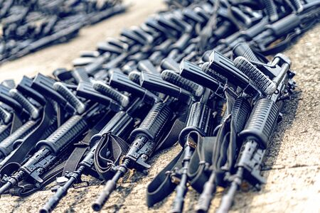Lots of Black Assault Rifle on The Ground. Concept of The Right To Keep and Bear Arm or Gun Of Second Amendment. 版權商用圖片