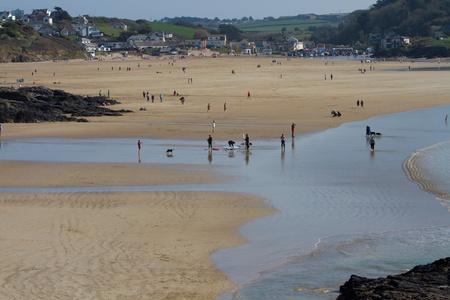 Holiday makers on Polzeath beach