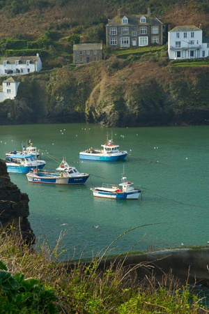 Boats sheltering in the harbour at Port Isaac fishing village in Cornwall