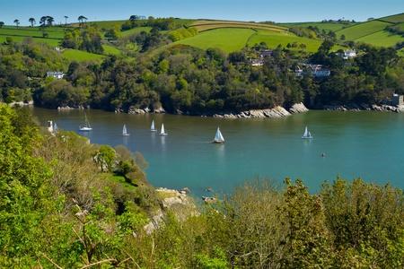 Yachts sailing on the River Dart near Dartmouth Devon photo