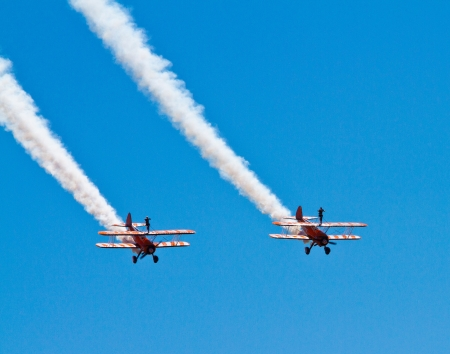 WESTON-SUPER-MARE, SOMERSET-JULY 24th 2012   The Grand Pier Air Show in Weston-super-Mare on Tuesday 24th July 2012   Breitling Wingwalkers Display team perform on biplanes for the thrilled crowds on a stunning day Editorial