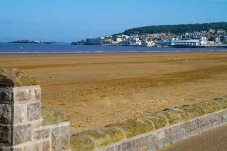 brean down: Weston-super-Mare beach with both piers in the background Stock Photo