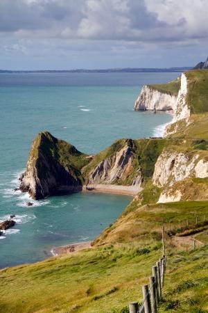 durdle: Dorset coastline looking towards Durdle Door, the route of the South-West coastal path    Stock Photo