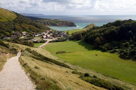 South-West coastal path overlooking Lulworth Cove and Dorset coastline Stock Photo