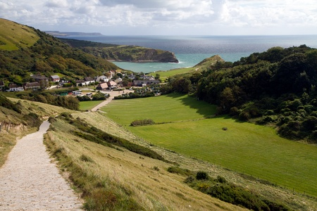 South-West coastal path overlooking Lulworth Cove and Dorset coastline Stock Photo