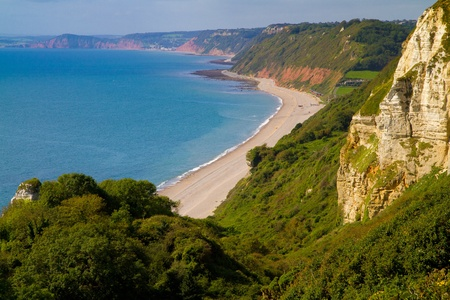 Branscombe beach and Devon coast part of the South-West coastal path looking towards Sidmouth and Ladram Bay Stock Photo