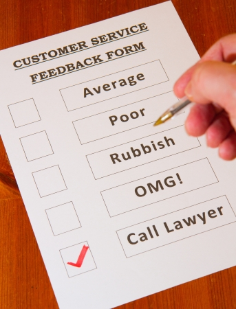Fun Customer Service Feedback Form loaded with bad options including average, poor, rubbish, OMG and  Call lawyers Stock Photo - 16806764