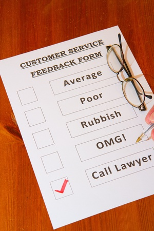 Fun Customer Service Feedback Form loaded with bad options including average, poor, rubbish, OMG and  Call lawyers Stock Photo - 16806751