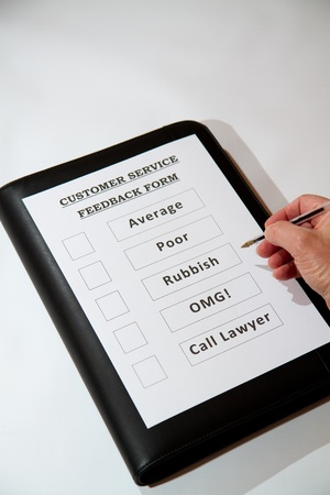 Fun Customer Service Feedback Form loaded with bad options including average, poor, rubbish, OMG and  Call lawyers  Stock Photo - 16806760