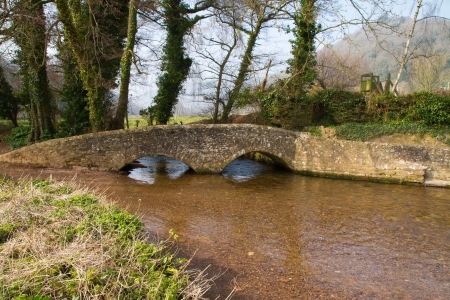 county somerset: Dunster, Somerset, England Gallox Bridge a listed building over the River Avill