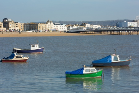 birnbeck: Boats in Weston-super-Mare Somerset bay and sea front view to Grand Pier
