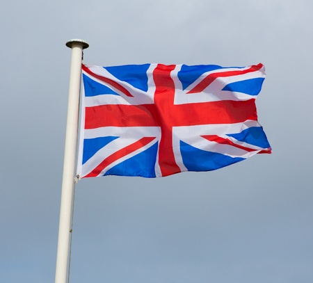 Union Jack Flag of Great Britain blowing in the breeze   The British flag photo