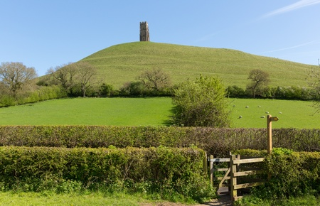 Glastonbury Hill Tor Somerset England which features the roofless St  Michael s Tower  It is a Scheduled Ancient Monument at the location believed by some to be the Avalon of King Arthur legend  Stock Photo