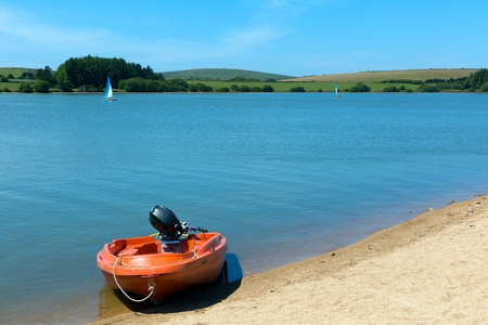 bodmin: Boat and blue water lake Siblyback near Liskeard Bodmin Moor Cornwall England UK