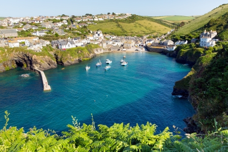 Port Isaac harbour Cornwall England UK with blue sea on a beautiful sunny day