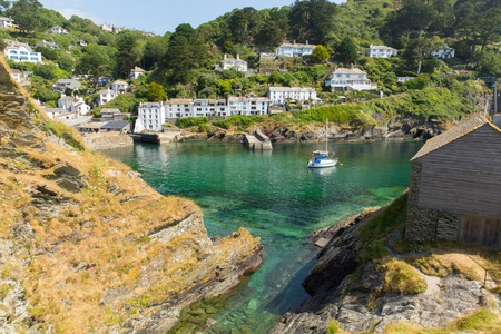 View from rocks at entrance to Polperro fishing village harbour Cornwall England UK Stock Photo