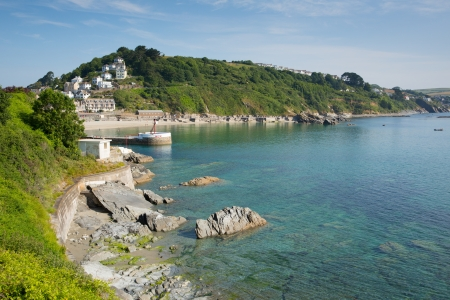 Coast view of Looe Cornwall with blue sea and sky and harbour entrance Stock Photo