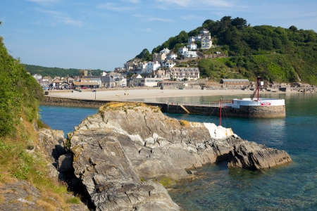 Looe harbour and beach Cornwall with blue sea and sky in this beautiful coastal town