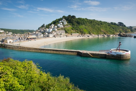 Looe harbour Cornwall with blue sea and sky