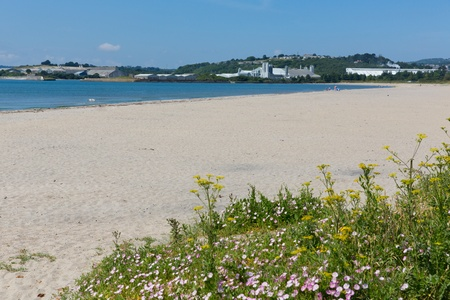 Sandy beach at Par Cornwall England with blue sea and sky on a beautiful summer day photo