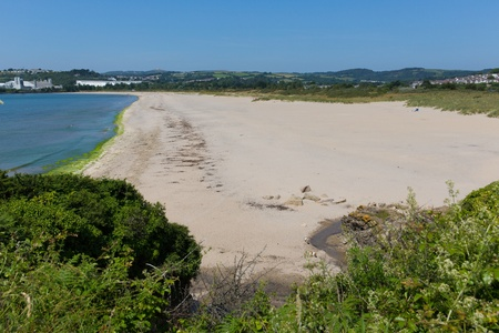 Par sandy beach Cornwall England near St Austell and Polkerris with blue sea and sky on a beautiful summer day