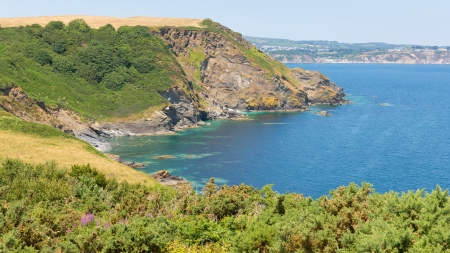 View of St Austell Bay from Black Head headland towards Porthpean and Par Cornwall England on a beautiful summer day    Stock Photo