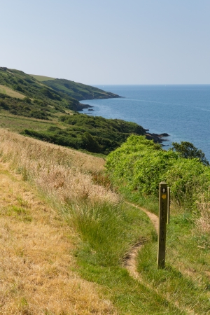 South West Coast Path from Polkerris Cornwall heading in a southerly direction on a beautiful summer day Stock Photo