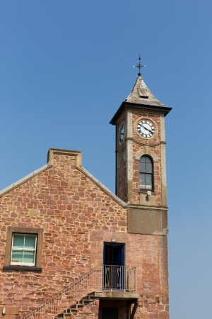 hamlet: Clock tower with blue sky Kingsand Cornwall