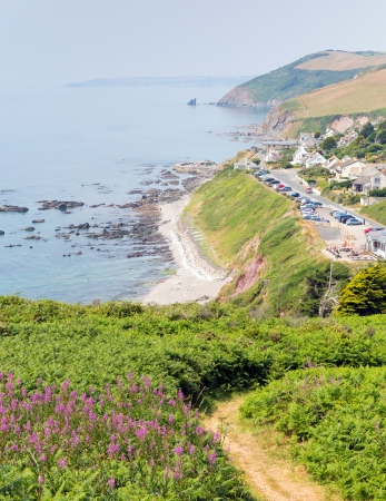 Portwrinkle village and coast Whitsand Bay near Looe Cornwall England United Kingdom on South West Coast Path photo