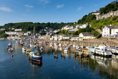 Looe Cornwall boats on river on beautiful day
