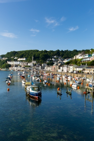 Boats and yachts on Looe river Cornwall with blue sea and sky