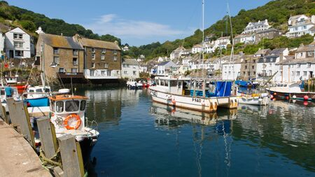 Polperro boats in harbour Cornwall England UK